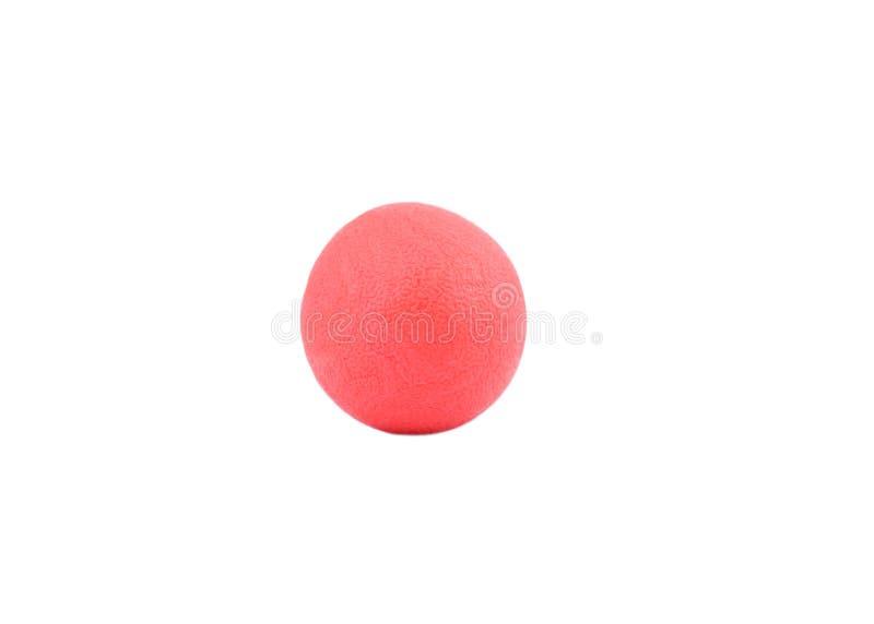 Rode rubberbal op geïsoleerde witte achtergrond stock foto's