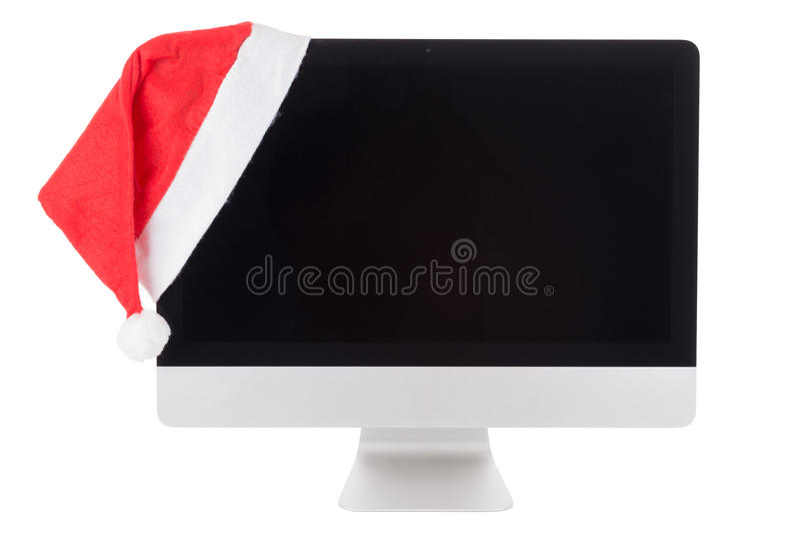 Rode santahoed op de Moderne Computermonitor royalty-vrije stock fotografie