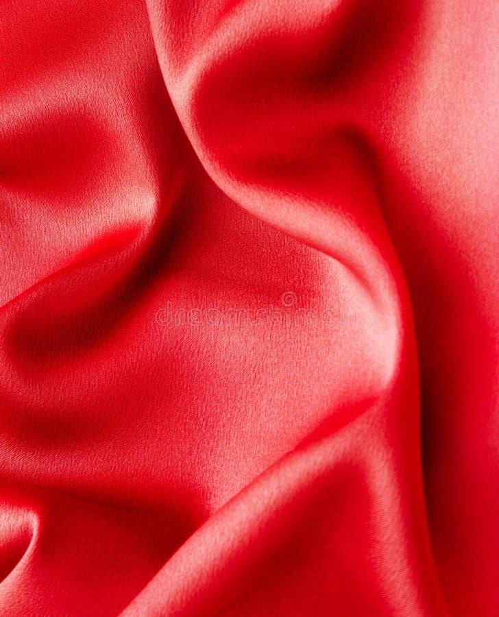 Rode satijnachtergrond royalty-vrije stock foto's