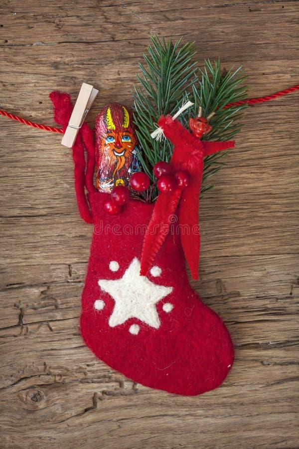 Rode sok met chocolade Krampus royalty-vrije stock afbeeldingen