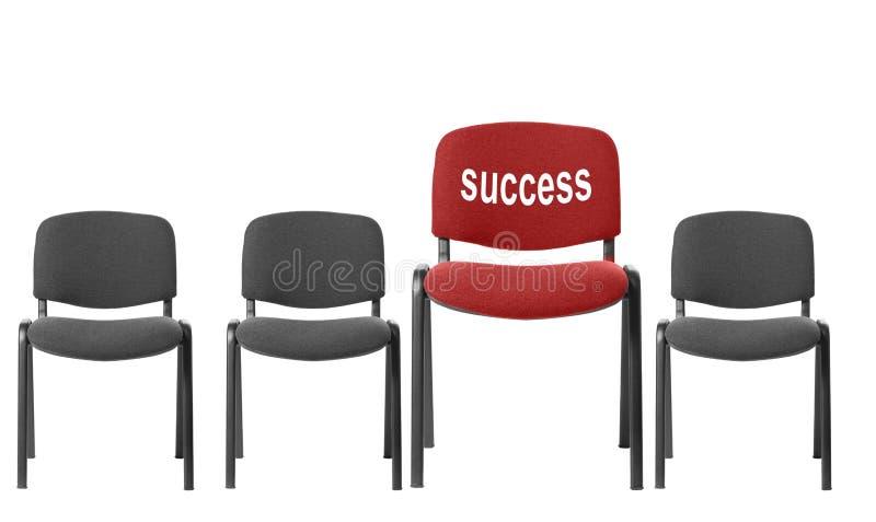 Rode stoel met een inschrijving - succes royalty-vrije stock afbeeldingen