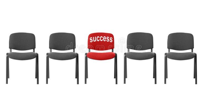 Rode stoel met een inschrijving - succes royalty-vrije stock foto