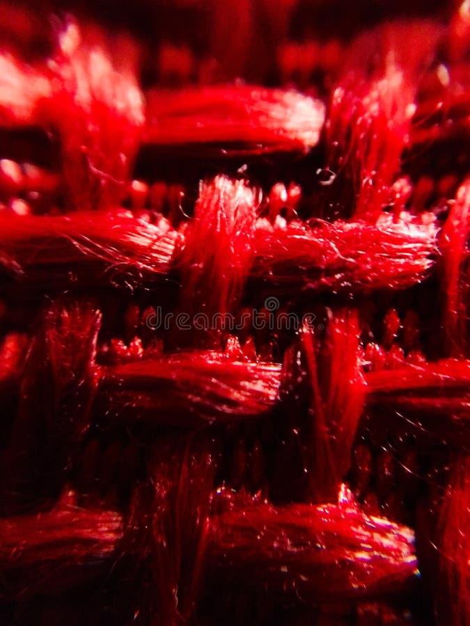 Rode stoffen dichte omhooggaand stock afbeeldingen