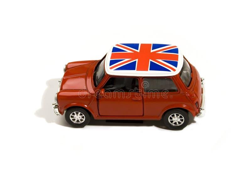 Rode stuk speelgoed auto met Britse vlag royalty-vrije stock afbeeldingen
