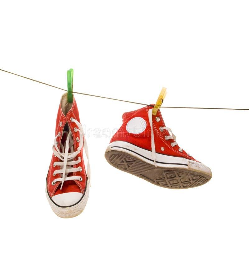 Rode tennisschoenen royalty-vrije stock foto