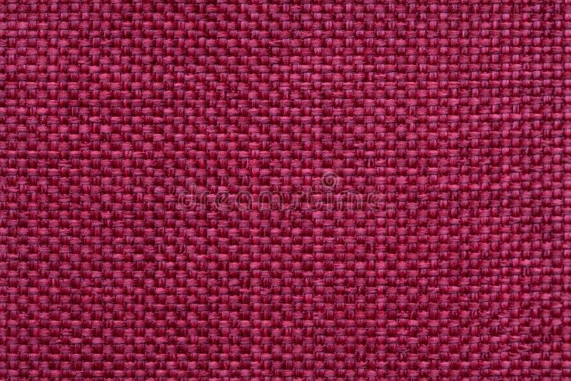 Rode textielachtergrond met geruit patroon, close-up Structuur van de stoffenmacro stock foto's