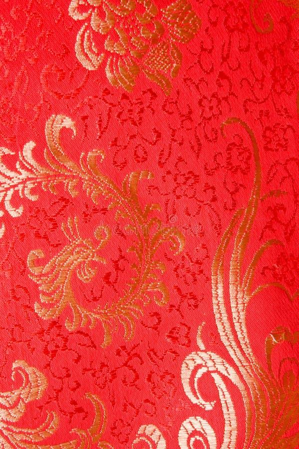 Rode traditionele Chinese zijdekleding stock fotografie