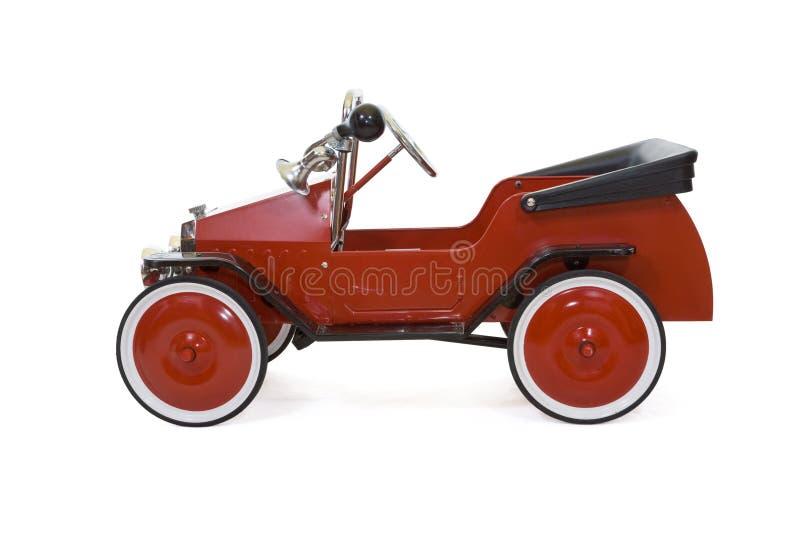 Rode uitstekende stuk speelgoed geïsoleerdeg auto - royalty-vrije stock afbeeldingen