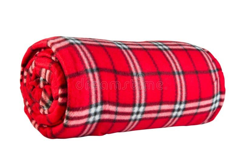 Rode vachtdeken in kooi stock afbeelding
