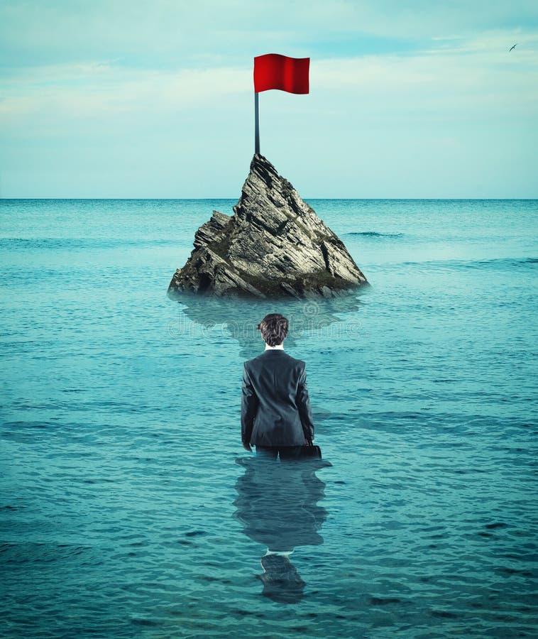 Rode vlag in de oceaan royalty-vrije stock afbeelding