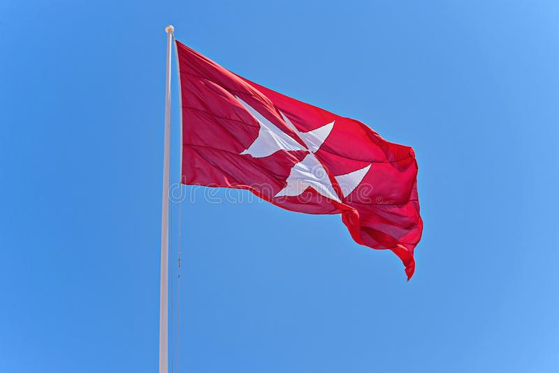 Rode vlag met zwart kruis royalty-vrije stock afbeeldingen