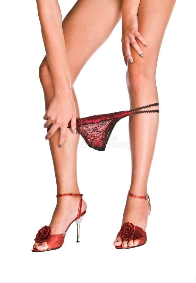 Rode vrouwelijke borrels die neer op mooi wijfje vallen royalty-vrije stock afbeelding