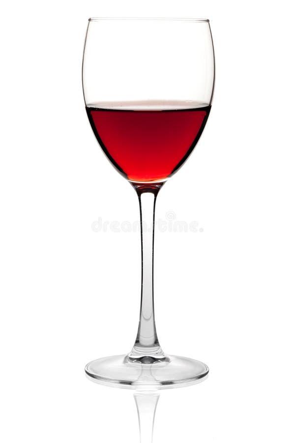 Rode wijn in een klein glas royalty-vrije stock afbeeldingen