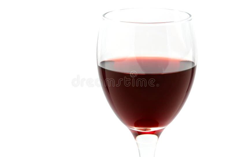 Rode wijn in een kop stock afbeeldingen