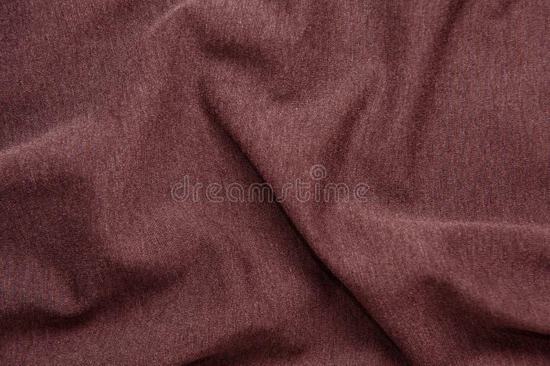 Rode wijn-gekleurde stoffentextuur royalty-vrije stock fotografie