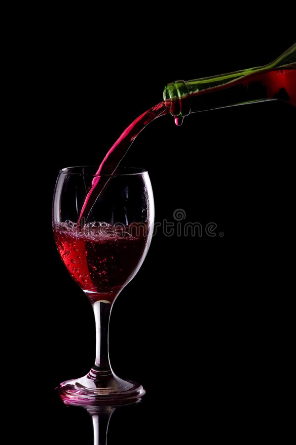 Rode wijn in glas royalty-vrije stock foto's