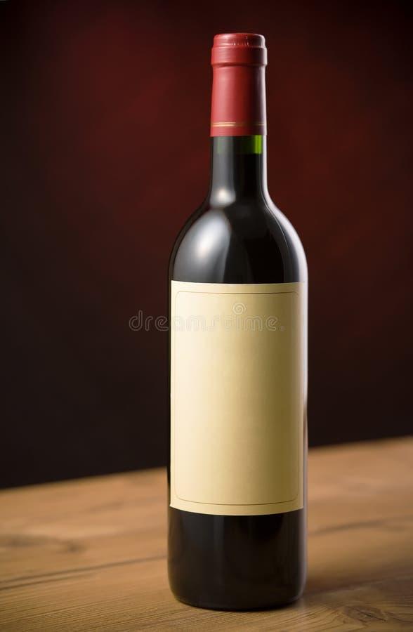 Rode wijnfles stock foto