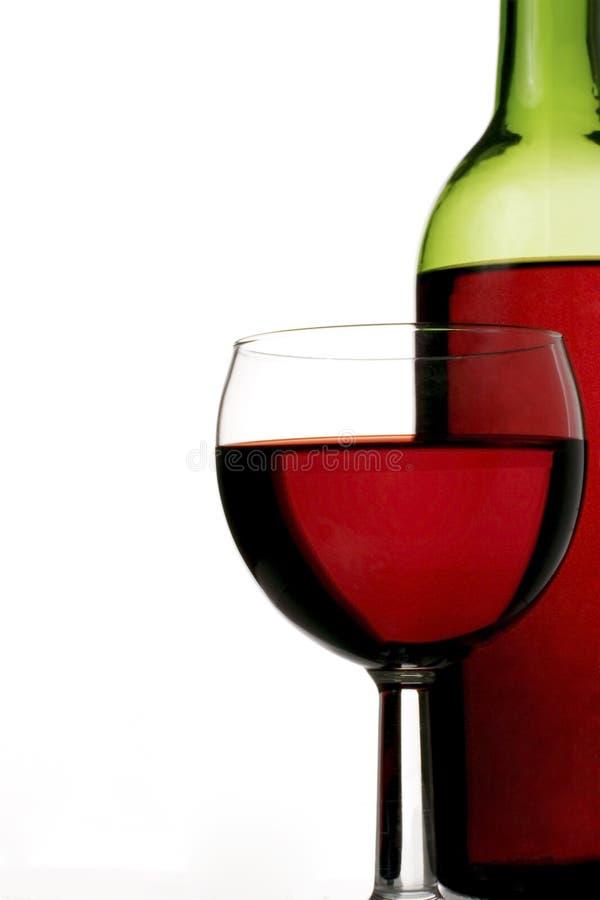 Rode wijnglas en fles royalty-vrije stock fotografie