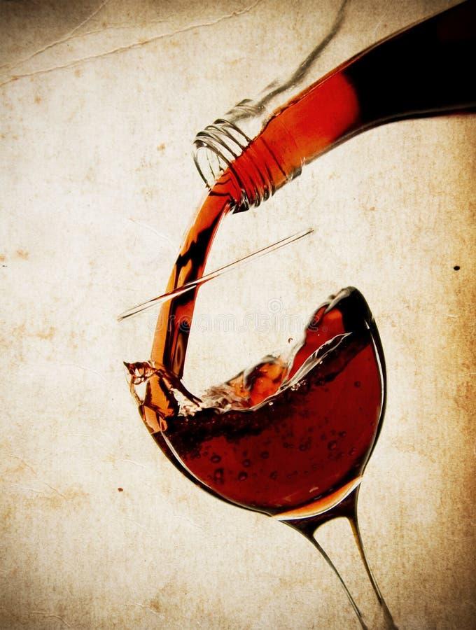 Rode wijnstok in glas stock afbeeldingen