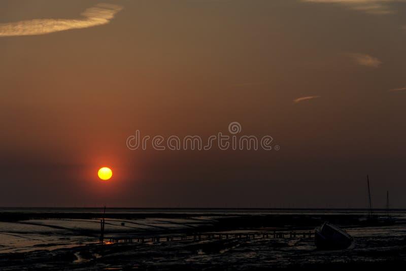 Rode Wirral-Zonsondergang stock foto's