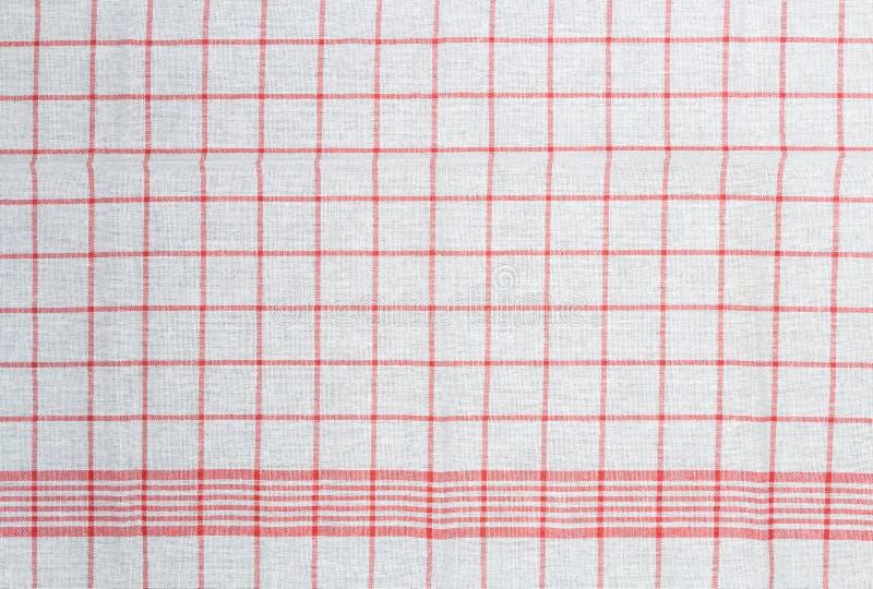 Rode witte gecontroleerde van de keukenhanddoek structuur als achtergrond stock foto