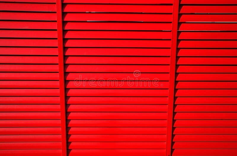 Rode zonneblinden stock fotografie