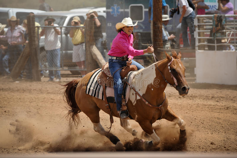 Rodeo Barrel Racing. A cowgirl rounds a barrel during the barrel racing competition at the Galiesto, New Mexico rodeo on July 21, 2013 royalty free stock image