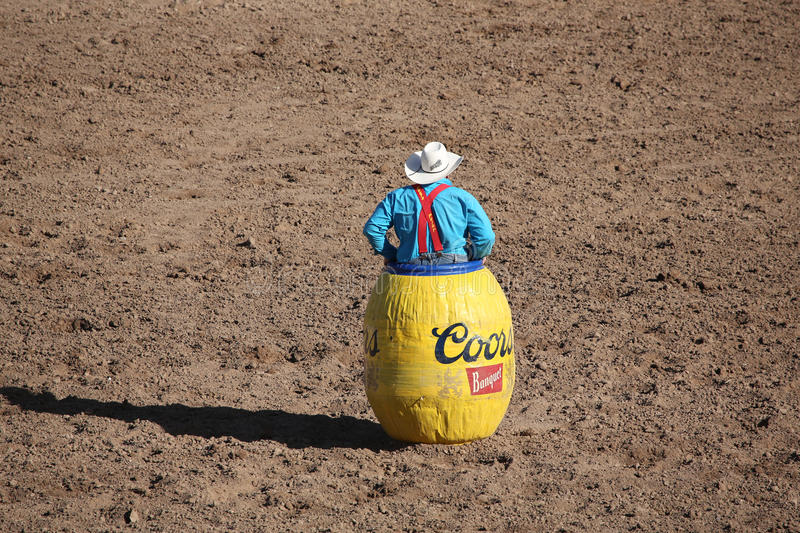 Rodeo Clown In A Barrel Watching Bull Editorial Photo