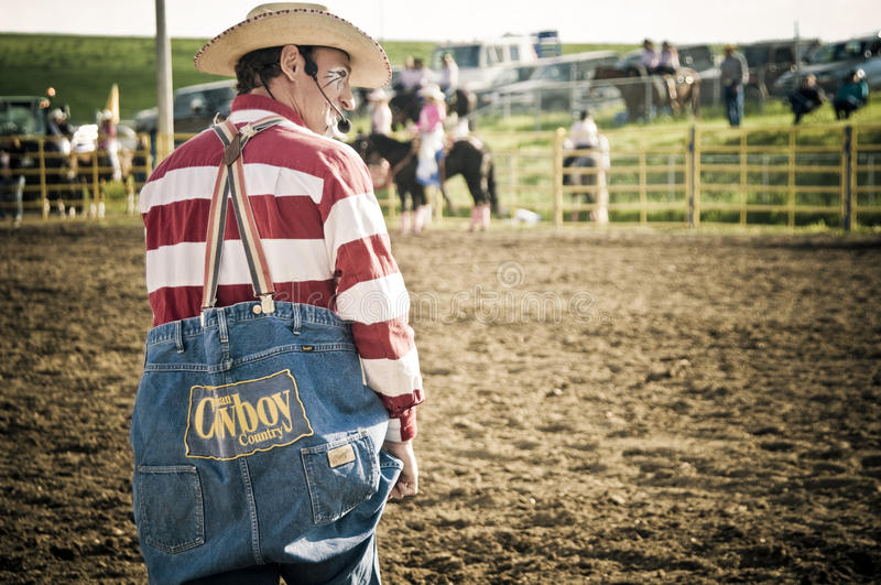 Rodeo clown and cowboys royalty free stock image