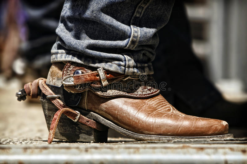 Rodeo Cowboy Boot and Spur. Close up of a rodeo cowboy's boot and spur as he prepares behind the chutes for an upcoming ride royalty free stock photos
