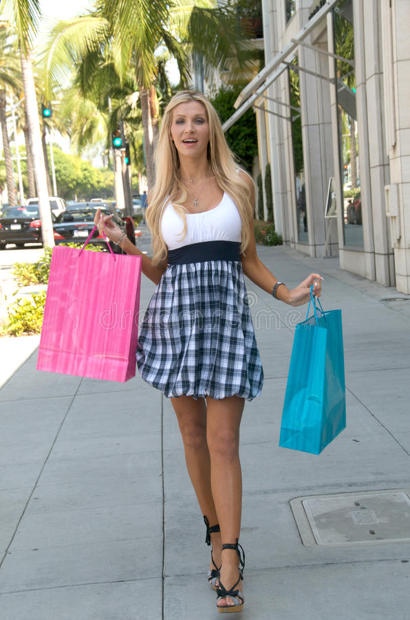 Rodeo Drive Shopping Day. A young woman enjoys a day of shopping on the famed Rodeo Drive stock image