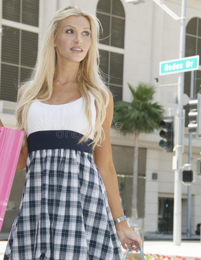 Rodeo Drive Shopping Day. A young woman enjoys a day of shopping on the famed Rodeo Drive royalty free stock images