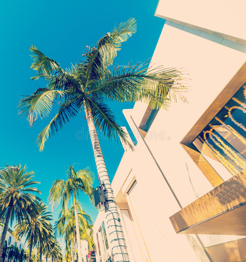 Rodeo drive in vintage tone. Blue sky over Rodeo drive, California stock image
