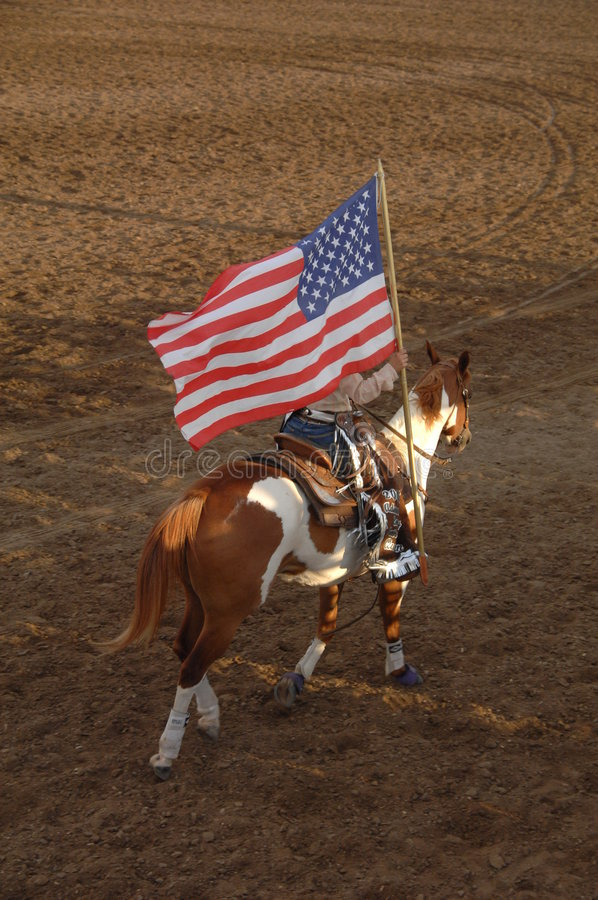 Rodeo Queen with Flag stock photography