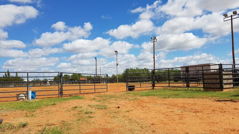 Rodeo training grounds cloudy blue sky royalty free stock image