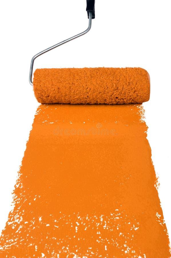 Rodillo con la pintura anaranjada foto de archivo libre de regalías