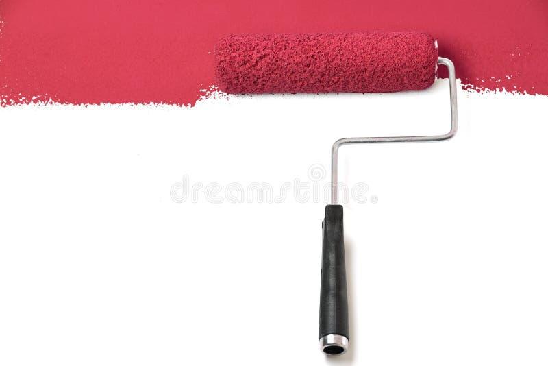 Rodillo de pintura rojo sobre blanco fotografía de archivo libre de regalías