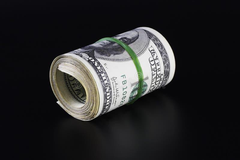 Rodillo del dinero (aislado en negro) fotos de archivo libres de regalías