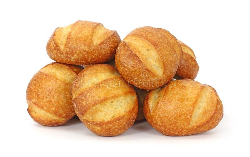 Rodillos de pan duros recientemente cocidos al horno imagenes de archivo