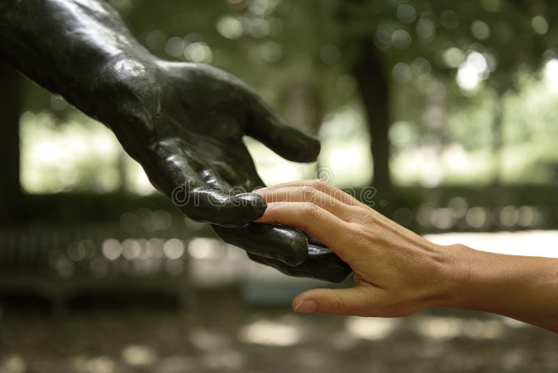 Rodin statue with human hands. Rodin statue with sensitive human hands in a garden of the Rodin Museum, Paris, France royalty free stock photography