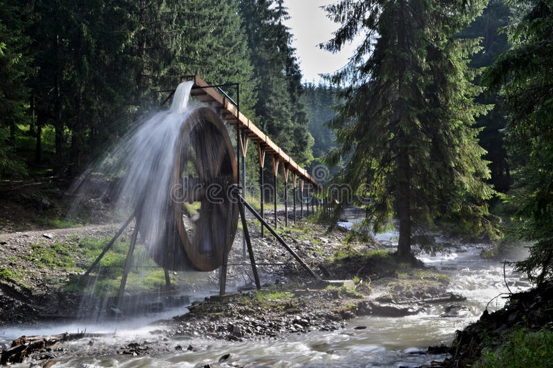 Rodna mountains in Romania - water wheel at Iza river source. The picture from Rodna mountains (Eastern Carpathians) in northern Romania. A water wheel - the stock photos