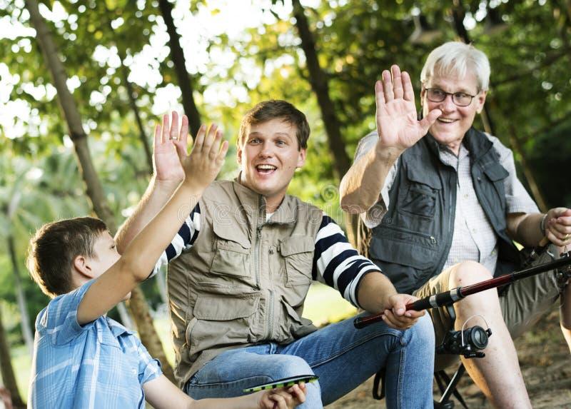 Rodzina robi wysocy pięć podczas gdy łowiący zdjęcia royalty free