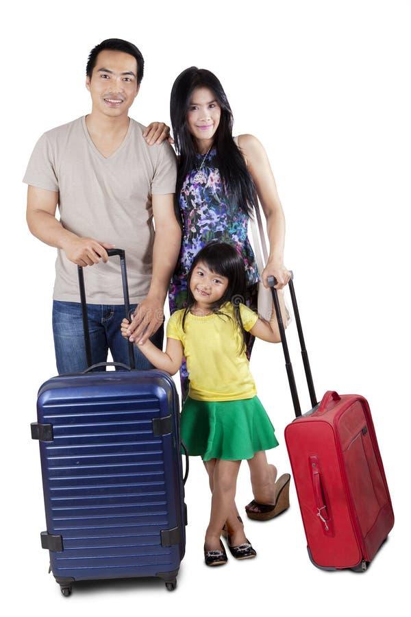 Rodzina z bagażem w studiu zdjęcia stock