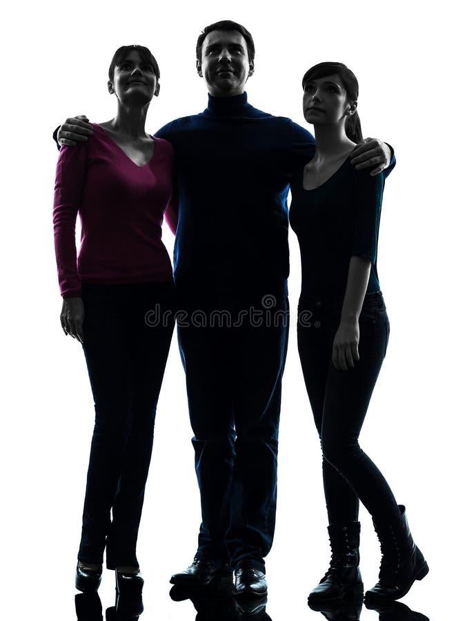 Rodzinna ojciec matki córka stoi pełnej długości przyglądający up