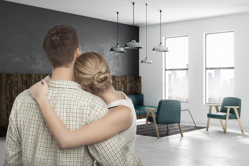 Rodzinna para w nowożytnym żywym pokoju obrazy stock