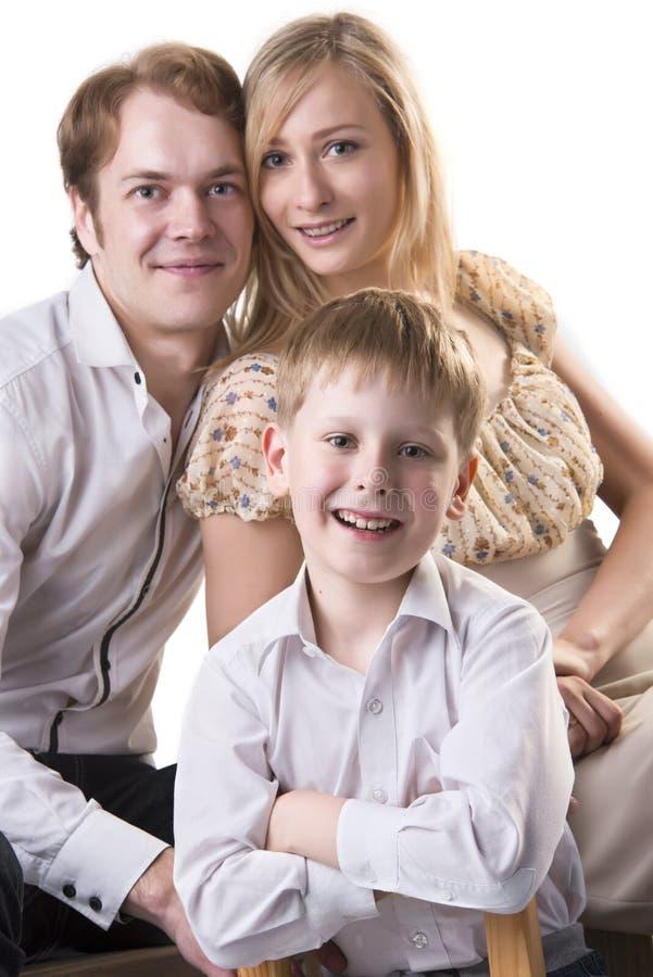 Rodzinny portret: Matka, ojciec i dziecko, fotografia stock