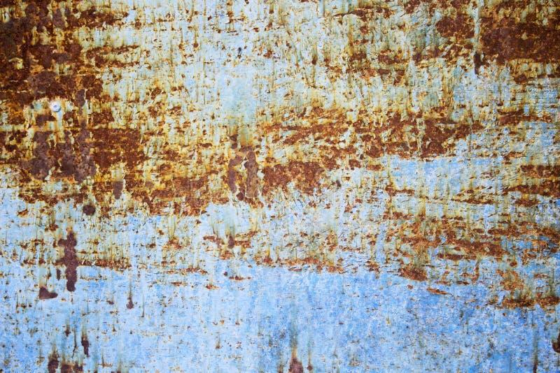 Roestachtergrond op blauwe staalplaat voor grafisch ontwerp stock foto's