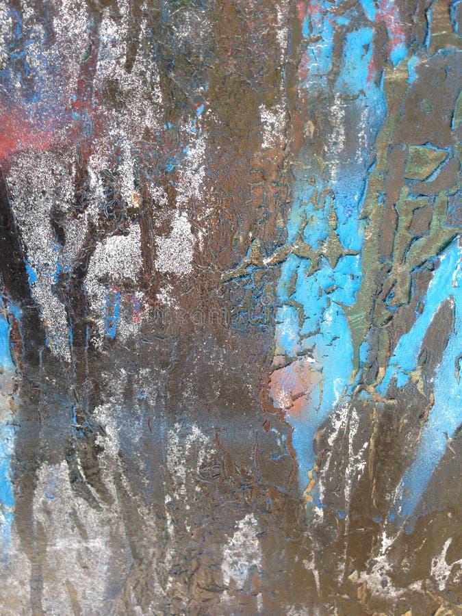 Roestig en ijzig blauw met de wenk van rood op zwarte royalty-vrije stock foto's