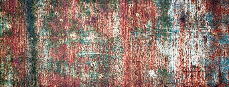 Roestige die metaaltextuur in verschillende kleuren, gekleurd ijzer wordt geschilderd wa stock foto's