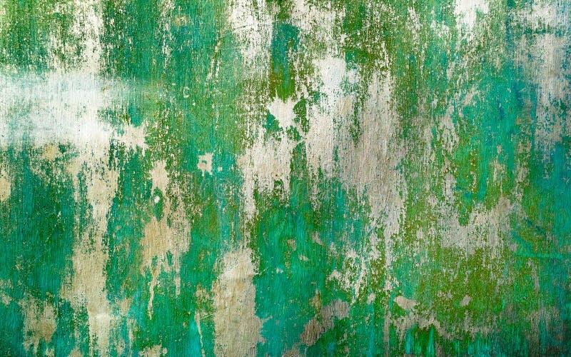 Roestige geschilderde groene metaaltextuur met gebarsten verf stock afbeeldingen